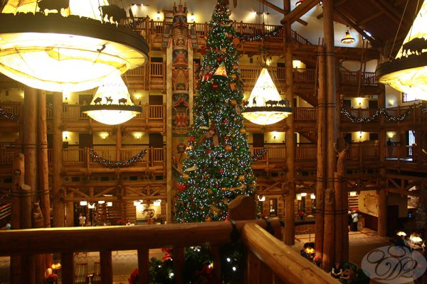 Relaxing back at the Wilderness Lodge in rocking chairsona balcony overlooking the festive lobby